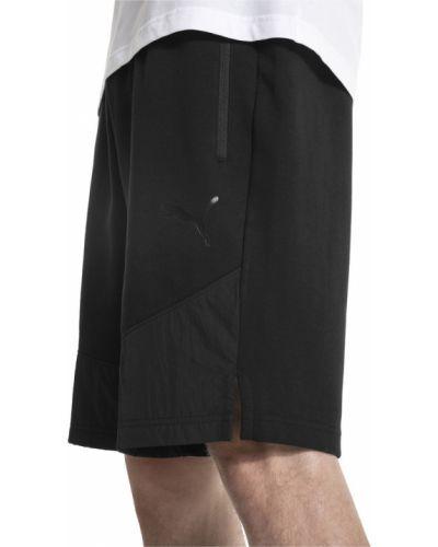 Короткие шорты черные в клетку Puma