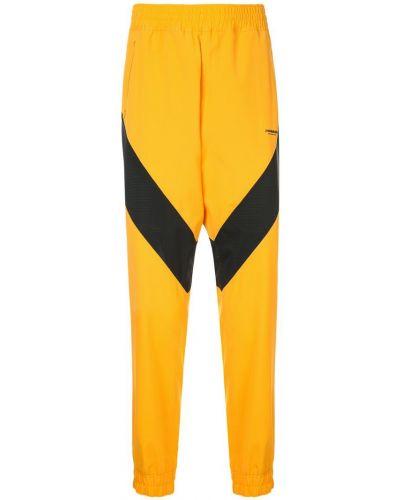 Желтые спортивные брюки с поясом с манжетами Yoshiokubo