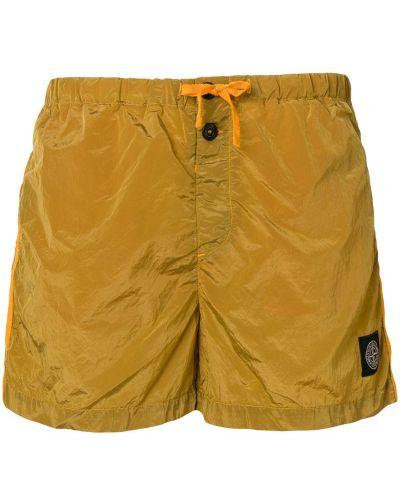 Оранжевые короткие шорты Stone Island
