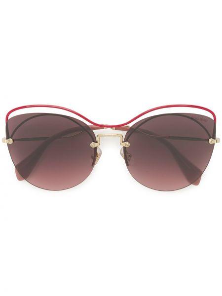 Розовые солнцезащитные очки металлические Miu Miu Eyewear