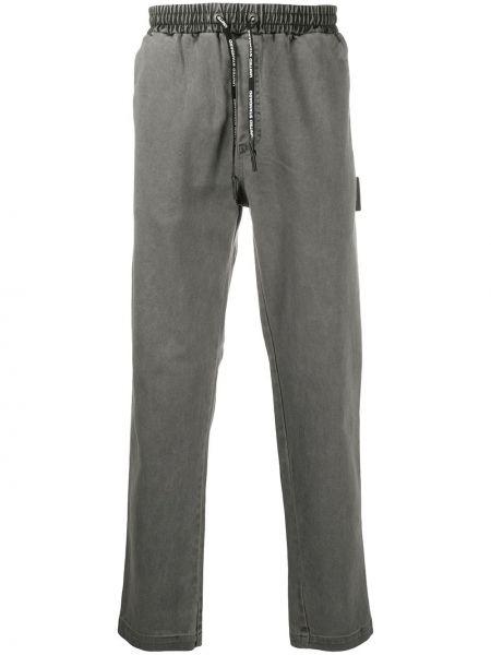 Прямые серые прямые джинсы с заплатками на резинке United Standard