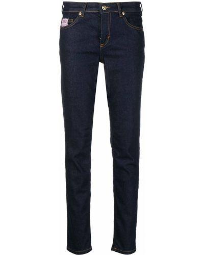 Хлопковые синие джинсы с низкой посадкой Versace Jeans Couture
