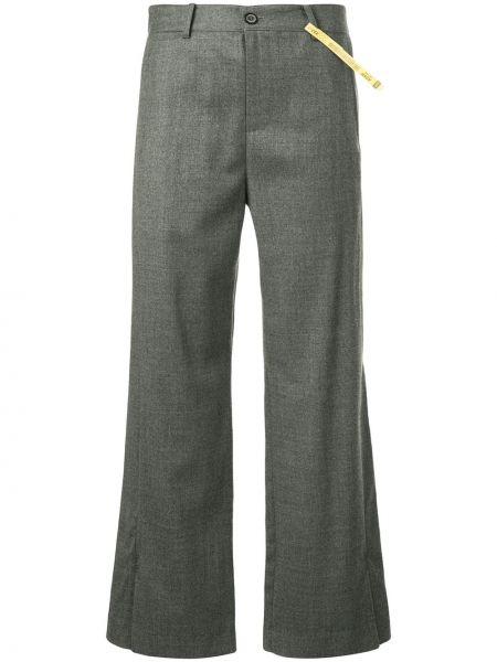 Spodnie wełniane z paskiem rozkloszowane Ader Error