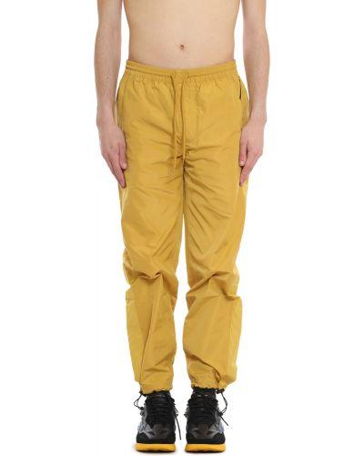 Żółte spodnie Pleasures