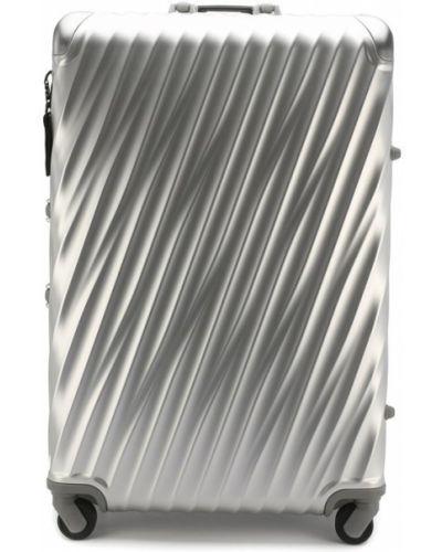 Чемодан дорожный из серебра Tumi
