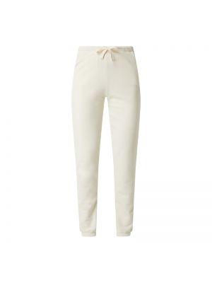 Białe spodnie bawełniane z printem Armedangels
