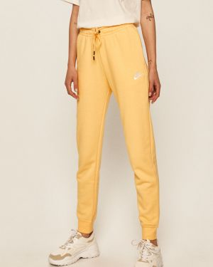 Żółte spodnie bawełniane Nike Sportswear
