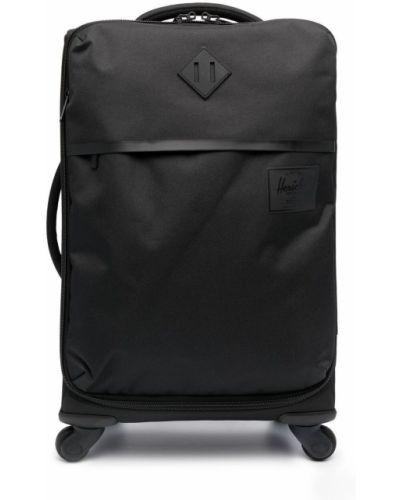 Черный чемодан круглый на молнии Herschel Supply Co