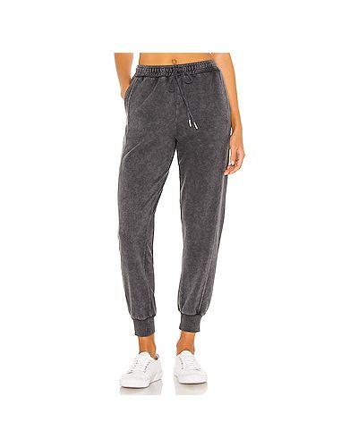Текстильные черные брюки в рубчик с карманами Lspace