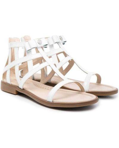 Белые кожаные сандалии на плоской подошве Florens