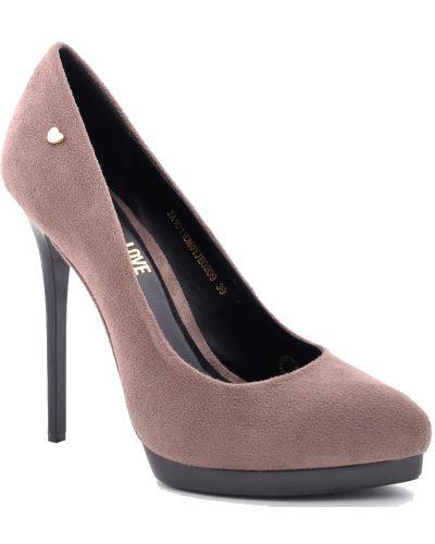 Кожаные туфли осенние на каблуке Moschino