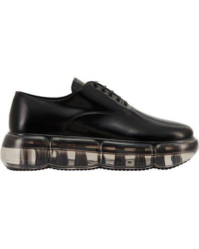 Кожаные ботинки на шнурках на тракторной подошве Prada