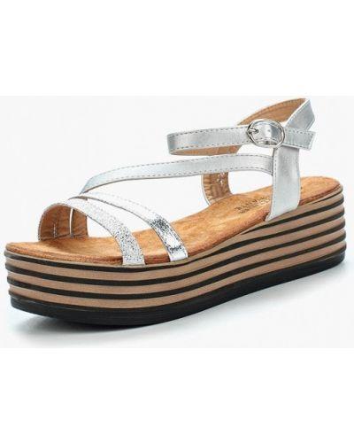 Босоножки на каблуке серебряного цвета La Bottine Souriante