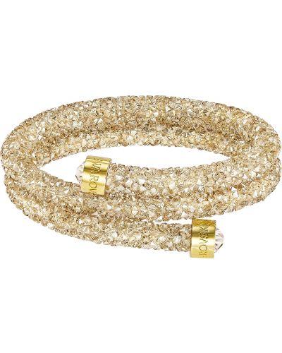 Золотой браслет с камнями металлический Swarovski