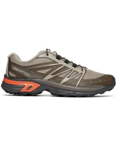 Кожаные черные кроссовки на шнурках Salomon