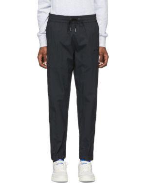 Spodnie na gumce z kieszeniami z suwakami Aime Leon Dore