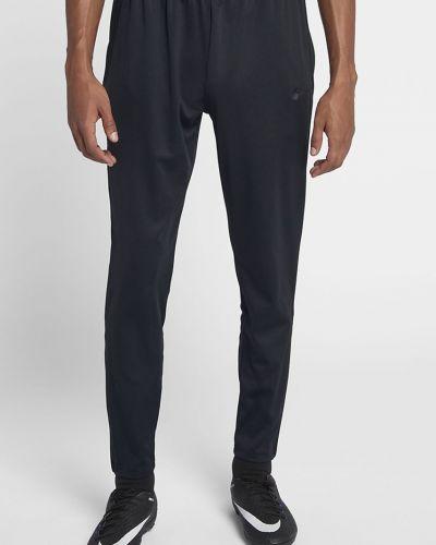 Зауженные брюки на резинке из полиэстера Nike