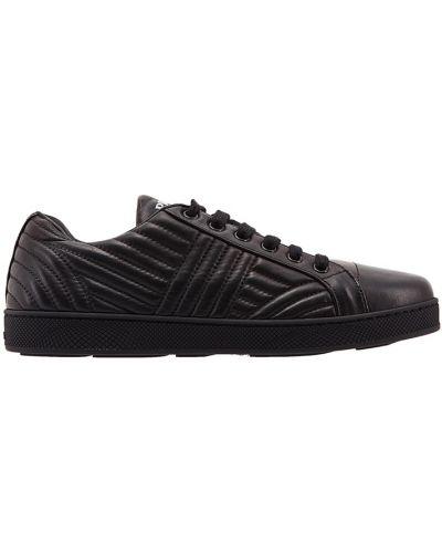 Кожаные кроссовки на шнуровке с узором Prada