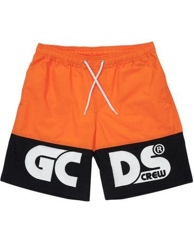 Нейлоновые оранжевые шорты эластичные Gcds
