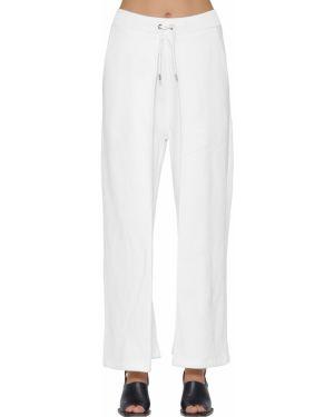 Białe joggery bawełniane peep toe Aalto
