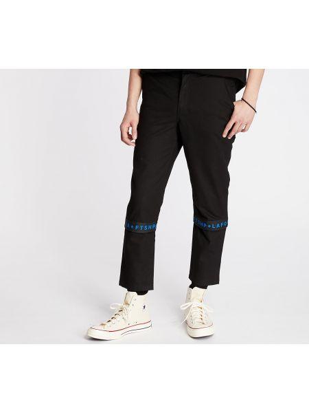 Czarne spodnie Footshop