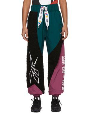 Нейлоновые фиолетовые брюки с вышивкой с манжетами Reebok By Pyer Moss