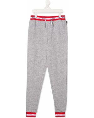 Sportowe spodnie z kieszeniami białe Little Marc Jacobs