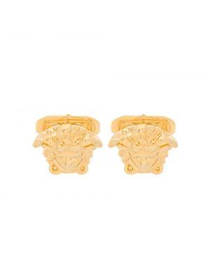 Złote spinki do mankietów Versace