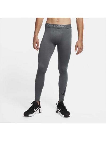Ciepłe szare legginsy Nike