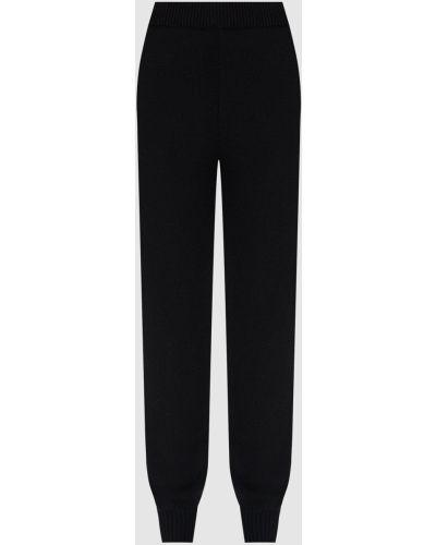 Шерстяные черные спортивные брюки Prada