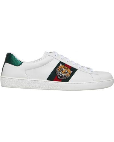 Кожаные кроссовки с вышивкой Gucci