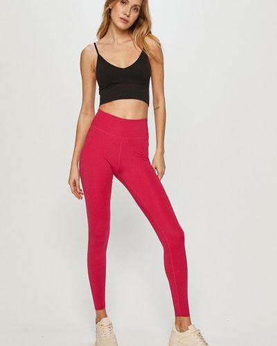 Różowe legginsy materiałowe Nike