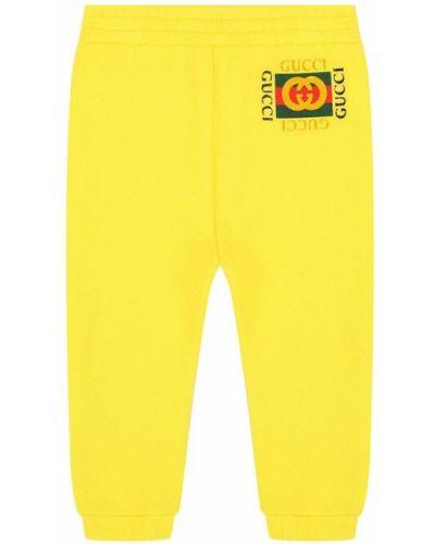 Желтые джоггеры Gucci