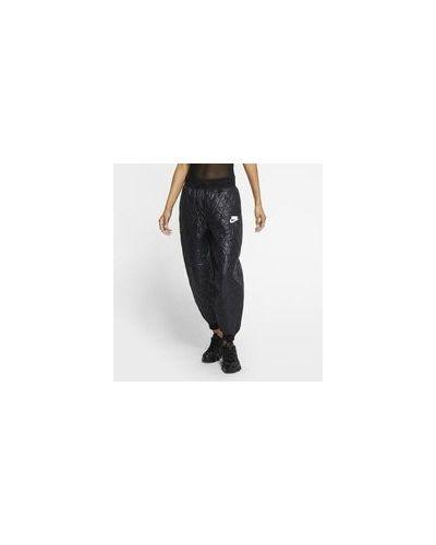 Флисовые повседневные спортивные брюки утягивающие со вставками Nike