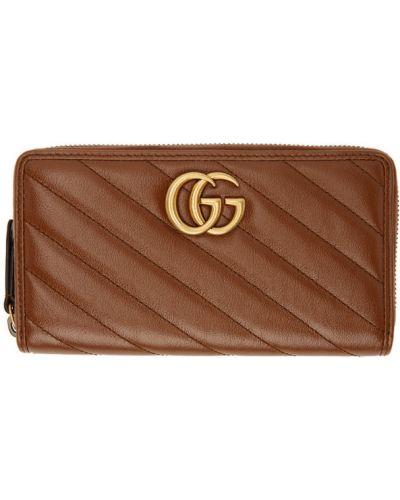 Skórzany portfel złoto prążkowany z gniazdem Gucci