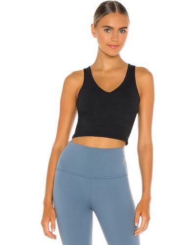 Czarny crop top na jogę rozciągać Beyond Yoga