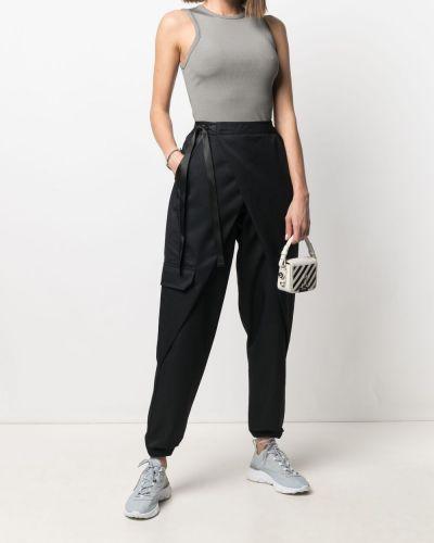 Черные зауженные брюки с запахом Nike