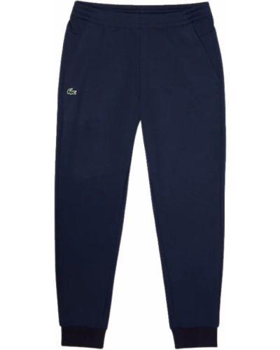 Niebieskie joggery Lacoste