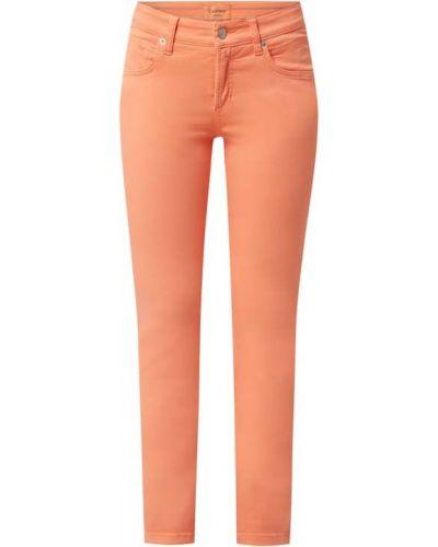 Pomarańczowe jeansy bawełniane Cambio