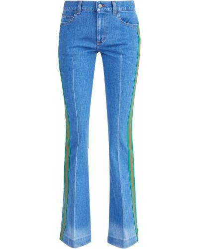 Расклешенные джинсы выбеленные со стрелками Gucci