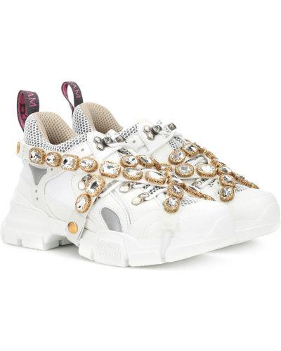 Кожаные кроссовки на резинке с вышивкой Gucci