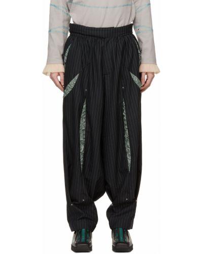 Satynowe białe spodnie z paskiem Kiko Kostadinov