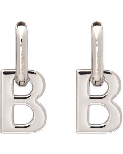 Серебряные мерцающие серьги-гвоздики Balenciaga