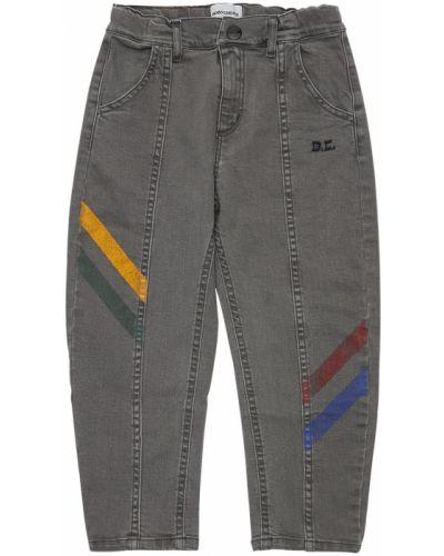 Niebieski jeansy z kieszeniami na przyciskach Bobo Choses