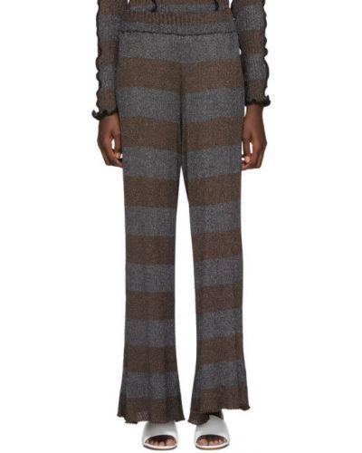 Серебряные расклешенные свободные брюки стрейч с люрексом Asai