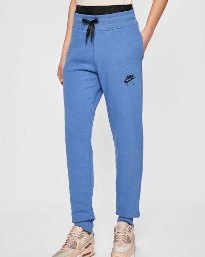 Спортивные брюки на резинке с карманами Nike