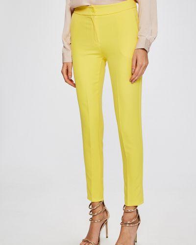 Желтые зауженные брюки Answear