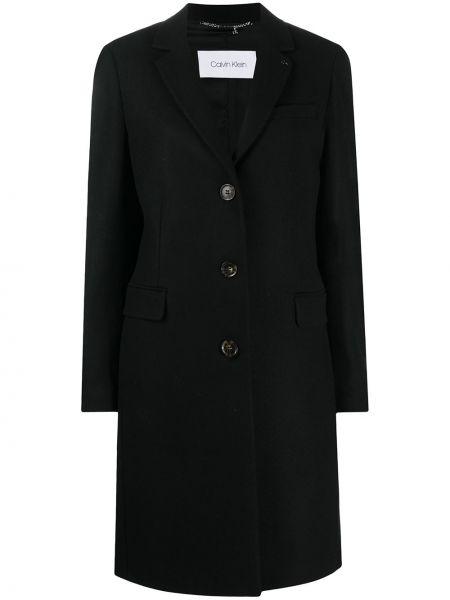 Шерстяное черное длинное пальто с карманами Calvin Klein
