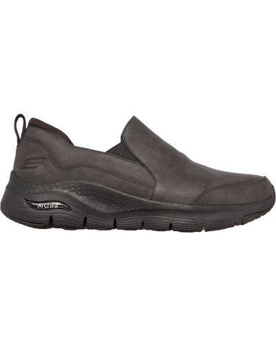 Черные кожаные слипоны Skechers