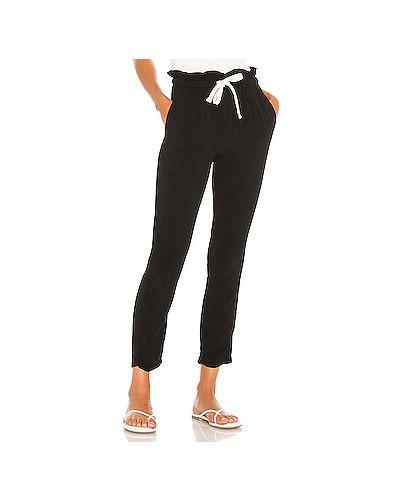 Шелковые черные брюки на резинке с завязками с карманами Monrow